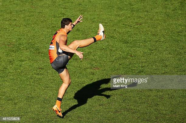 Jonathon Patton of the Giants kicks for goal during the round 14 AFL match between the Greater Western Sydney Giants and the Carlton Blues at...