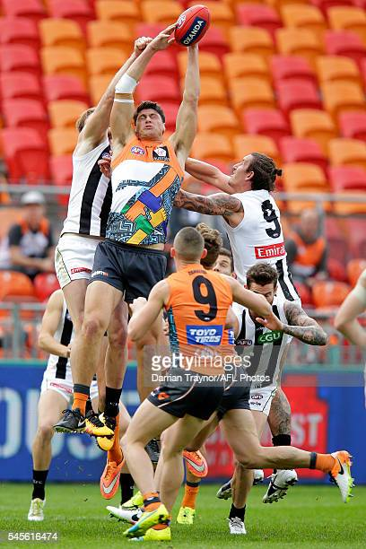 Jonathon Patton of the Giants marks the ball during the round 14 AFL match between the Greater Western Sydney Giants and the Carlton Blues at...