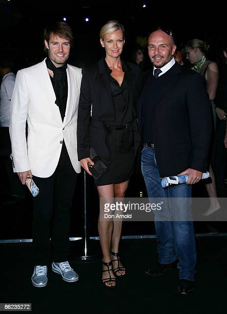 Jonathon Pease, Sarah Murdoch and Alex Perry pose prior to the Wayne Cooper show at the Overseas Passenger Terminal, Circular Quay on day one of...