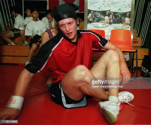 Jonathon Power of Canada streches his sore back during the final which Peter Nichol of England won in the Cathay Pacific Squash Open 01 September 2002