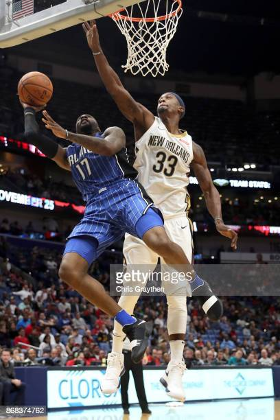Jonathon Simmons of the Orlando Magic makes a shot over E'Twaun Moore of the New Orleans Pelicans at the Smoothie King Center on October 30 2017 in...