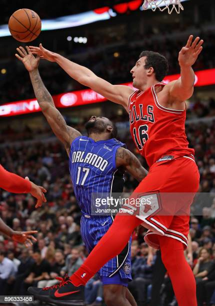Jonathon Simmons of the Orlando Magic puts up a shot against Paul Zipser of the Chicago Bulls at the United Center on December 20 2017 in Chicago...