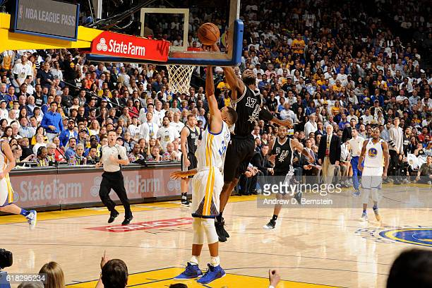 Jonathon Simmons of the San Antonio Spurs blocks a shot against Stephen Curry of the Golden State Warriors on October 25 2016 at ORACLE Arena in...