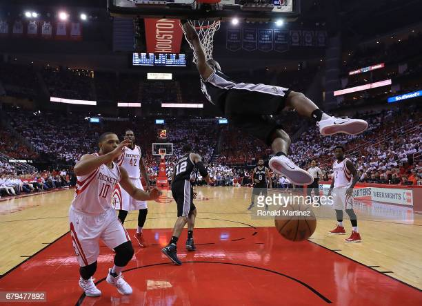 Jonathon Simmons of the San Antonio Spurs dunks against Eric Gordon of the Houston Rockets during Game Three of the NBA Western Conference SemiFinals...