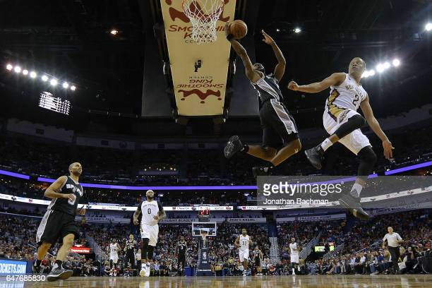 Jonathon Simmons of the San Antonio Spurs misses a shot as Tim Frazier of the New Orleans Pelicans defends during the first half of a game at the...