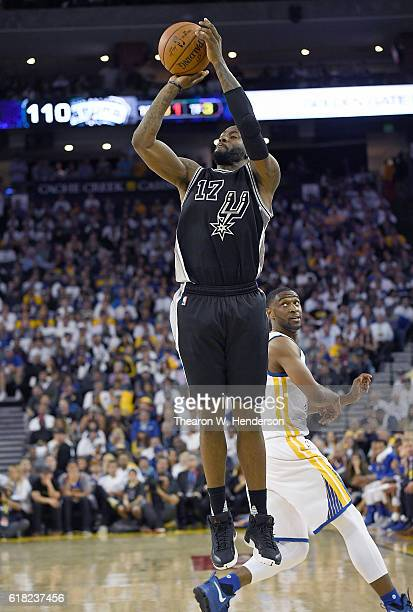 Jonathon Simmons of the San Antonio Spurs shoots against the Golden State Warriors during the fourth quarter in an NBA basketball game at ORACLE...