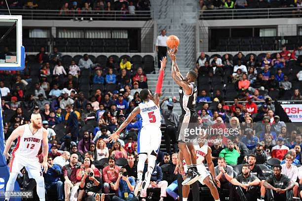 Jonathon Simmons of the San Antonio Spurs shoots the ball against the Detroit Pistons on October 10 2016 at The Palace of Auburn Hills in Auburn...