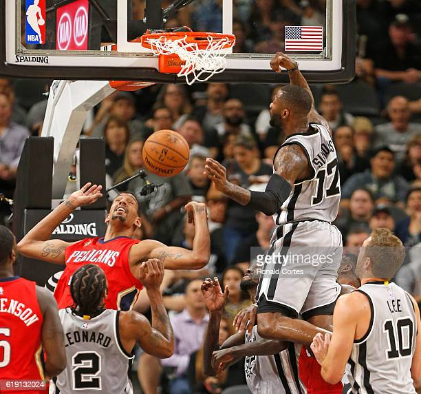 Jonathon Simmons of the San Antonio Spurs tries to tip in a shoot over Alexis Ajinca of the New Orleans Pelicans during game between New Orleans...