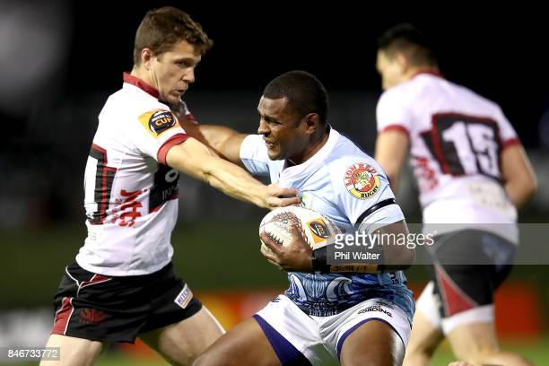 Jone Macilai of Northland is tackled by Matt Duffie of North Harbour during the round five Mitre 10 Cup match between Northland and North Harbour at...