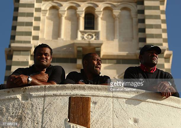 Jone Railomo captain Mosese Raululi and coach Ilie Tabuaat of of Fiji take in the view at the Basilique NotreDame de la Garde on October 4 2007 in...
