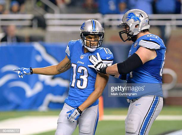 Jones of the Detroit Lions celebrates with teammate Travis Swanson after scoring his first NFL touchdown during the game against the San Francisco...