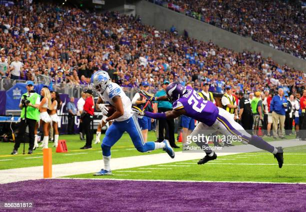 J Jones of the Detroit Lions lunges into the end zone with the ball for a successful two point conversion in the third quarter of the game against...