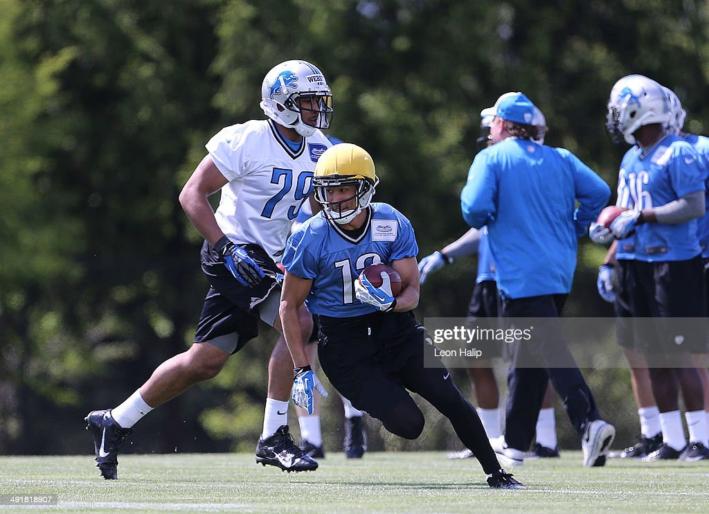 T. J. Jones #13 of the Detroit Lions runs through the punt return drills during the Rookie Minicamp on May 17, 2014 in Allen Park, Michigan.