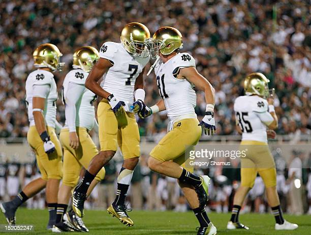 Jones of the Notre Dame Fighting Irish celebrates with John Goodman after Goodmans first quarter touchdown catch while playing the Michigan State...