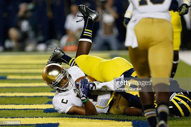 Jones of the Notre Dame Fighting Irish scores a touchdown during the game against the Michigan Wolverines at Michigan Stadium on September 7 2013 in...