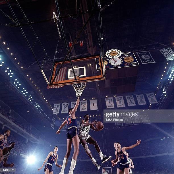 K C Jones#25 of the Boston Celtics drives to the basket against Wilt Chamberlain of the Philadelphia 76ers in 1968 during the NBA game at The Boston...