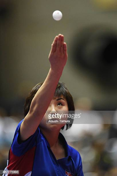 Jong Kim of North Korea serves against Ganna Gaponova of Ukraine during day five of the 2014 World Team Table Tennis Championships at Yoyogi National...