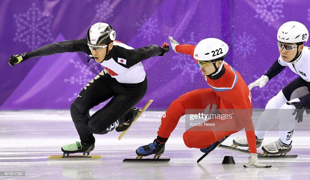 Jong Kwang Bom (222) of North Korea loses balance during a men's 500-meter short track speed skating competition in Gangneung, South Korea, at the Pyeongchang Winter Olympics on Feb. 20, 2018. ==Kyodo