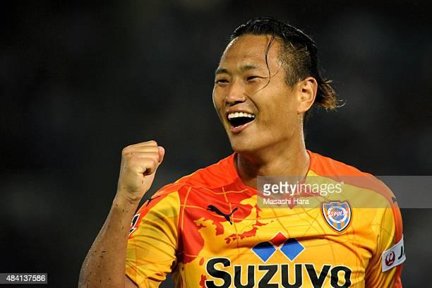Jong Tae se of Shimizu SPulse celebrates assisting his team's second goal during the JLeague match between Yokohama FMarinos and Shimizu SPulse at...