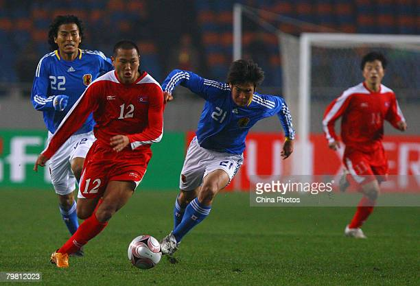 Jong Tae-se of North Korea vies for the ball with Kaji Akira of Japan during a match between Japan and Democratic People's Republic of Korea at the...