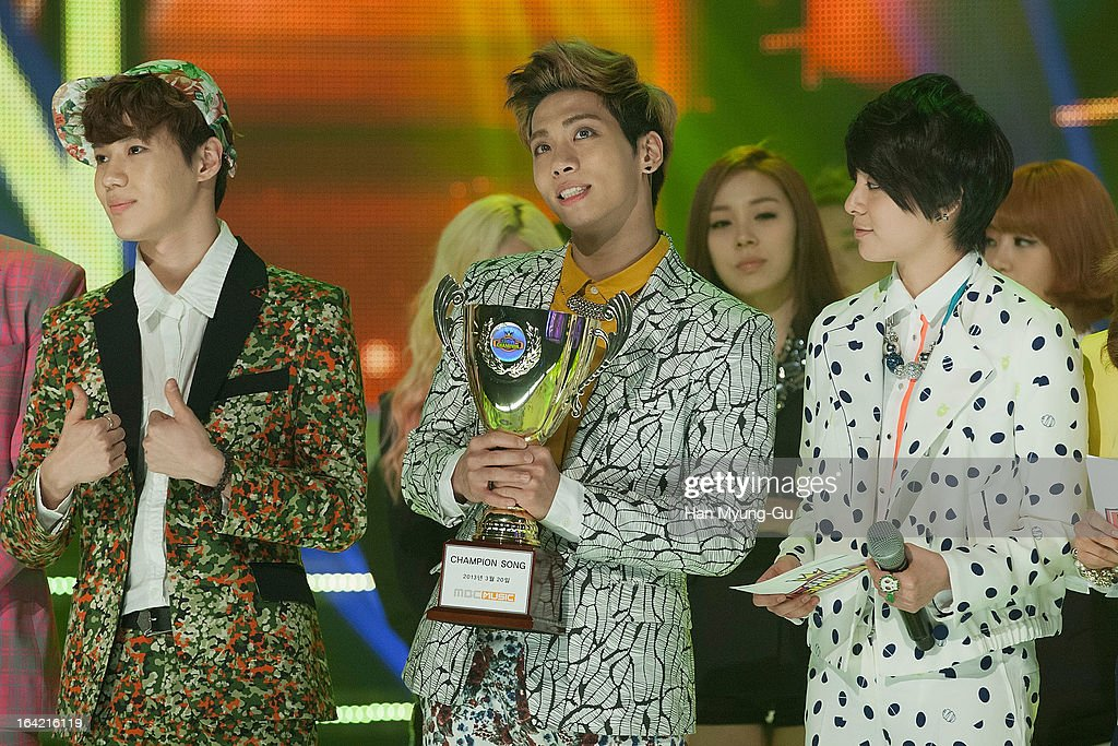 Jonghyun (C) of South Korean boy band SHINee gestures during as he holds trophy the MBC Music 'Show Champion' at Uniqlo-AX Hall on March 20, 2013 in Seoul, South Korea.