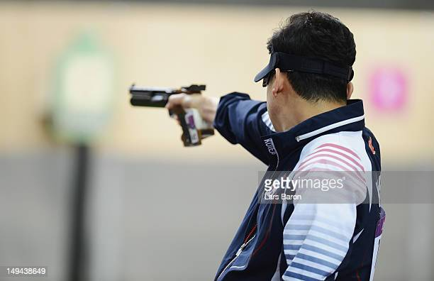 Jongoh Jin of Korea competes during the Men's 10m Air Pistol Shooting Final on Day 1 of the London 2012 Olympic Games at The Royal Artillery Barracks...