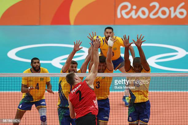 Jonh Gordon Perrin of Canada spikes the ball during the men's qualifying volleyball match between the Brazil and Canada on Day 4 of the Rio 2016...