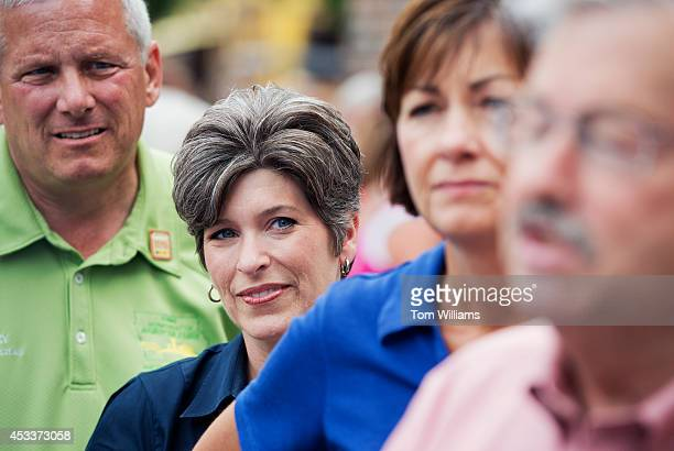 Joni Ernst Iowa Republican Senate candidate second from left attends at a news conference with Gov Terry Brandstad right Lt Gov Kim Reynolds and Bill...