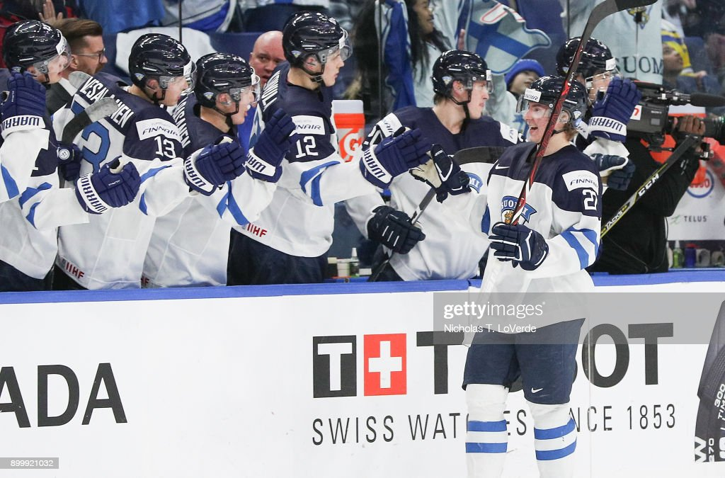 Joni Ikonen #27 of Finland celebrates his goal with the Finland bench players during play in the IIHF World Junior Championships at the KeyBank Center on December 30, 2017 in Buffalo, New York. Ikonen's goal gave Finland a 4-2 lead over Slovakia late in the third period.