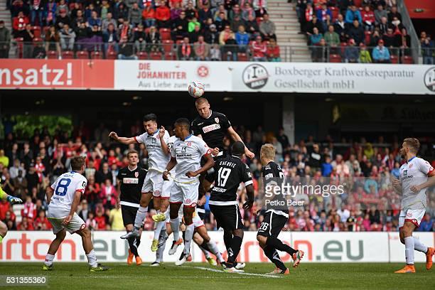 Joni Kauko is battling for a header during the Third League match between Energie Cottbus and 1 FSV Mainz 05 II at Stadion der Freundschaft on May 14...
