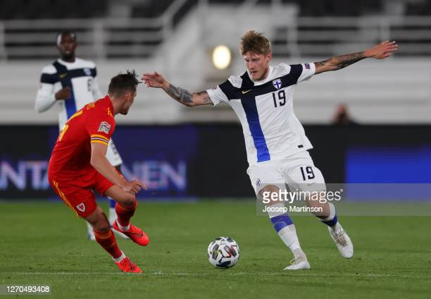 Joni Kauko of Finland battles for possession with Pau Torres of Spain during the UEFA Nations League group stage match between Finland and Wales at...