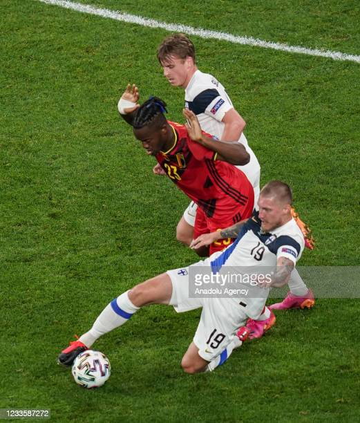 Joni Kauko of Finland in action against Michy Batshuayi of Belgium during the EURO 2020 Group B third match between Finland and Belgium at...