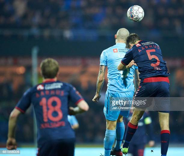 Joni Kauko of Randers FC and Alexander Juel Andersen of AGF Arhus heading the ball during the Danish Alka Superliga match between Randers FC and AGF...