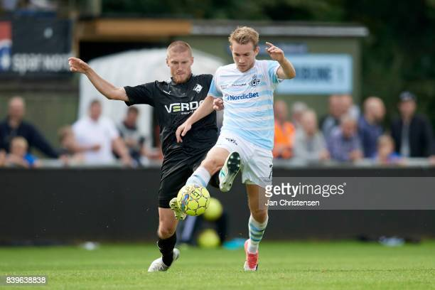 Joni Kauko of Randers FC and Anders Holst of FC Helsingor compete for the ball during the Danish Alka Superliga match between FC Helsingor and...