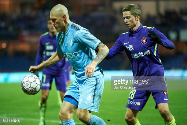 Joni Kauko of Randers FC and Andre Romer of FC Midtjylland compete for the ball during the Danish Alka Superliga match between Randers FC and FC...