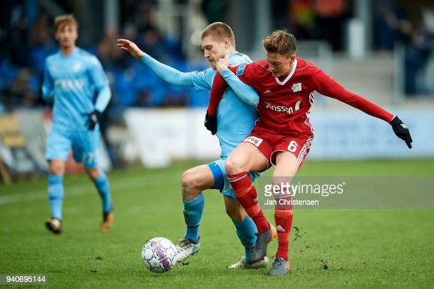 Joni Kauko of Randers FC anf Mathias Hebo Rasmussen of Lyngby BK compete for the ball during the Danish Alka Superliga match between Randers FC and...