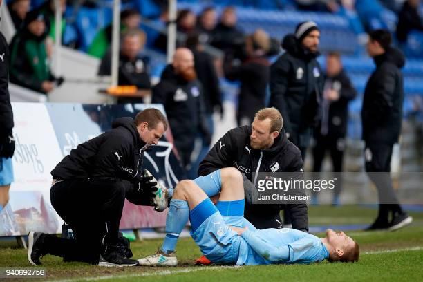Joni Kauko of Randers FC get an injury during the Danish Alka Superliga match between Randers FC and Lyngby BK at BioNutria Park Randers on April 01...