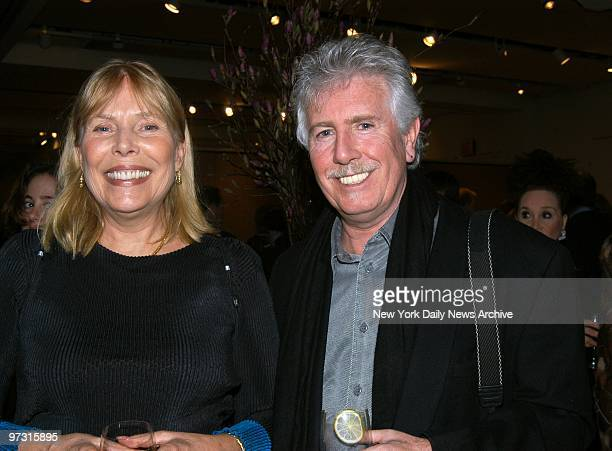 Joni Mitchell and Graham Nash are on hand for Aperture's 50th Anniversary Golden Gala benefit at Sotheby's New York Mitchell presented Nash a...
