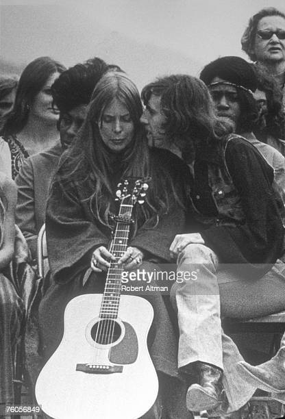 Joni Mitchell and Graham Nash take a break at The Big Sur Folk Festival held at the Eselen Institute on September 15 1969 in Big Sur California