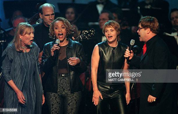 Joni Mitchell James Taylor Cassandra Wilson Shawn Colvin and Elton John perform together during the finale of Turner Network Television's AllStar...