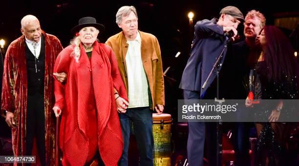 Joni Mitchell James Taylor Kris Kristofferson and Chaka Khan sing onstage at JONI 75 A Birthday Celebration Live at Dorothy Chandler Pavilion on...