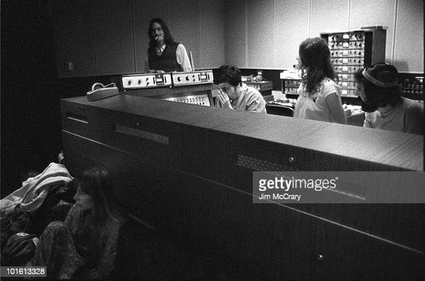 Joni Mitchell James Taylor recording engineer Hank Cicalo Carole King and record producer Lou Adler gather around the mixing desk for a playback in...
