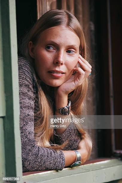 Joni Mitchell leaning out of the window of her house in Laurel Canyon.