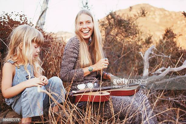 Joni Mitchell plays for a young girl at her house in Laurel Canyon