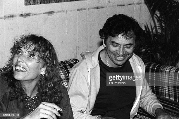 Joni Mitchell poses backstage with promoter Bill Graham during the Berkeley Jazz Festival at the Greek Theatre in May 1979 in Berkeley California