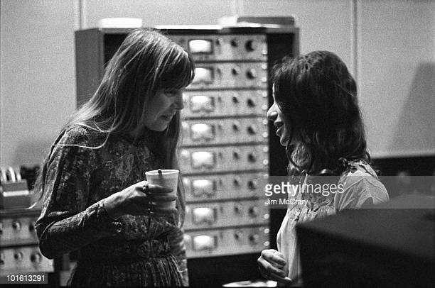 Joni Mitchell talks to Carole King in the control room of AM Records Recording Studio during the recording of King's album 'Tapestry' in January 1971...