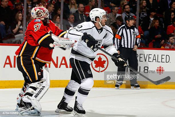 Joni Ortio of the Calgary Flames pushes Mike Richards of the Los Angeles Kings at Scotiabank Saddledome on February 27 2014 in Calgary Alberta Canada