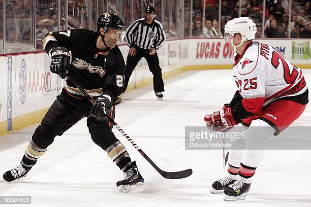 Joni Pitkanen of the Carolina Hurricanes defends against Scott Niedermayer of the Anaheim Ducks during the game on November 25 2009 at Honda Center...