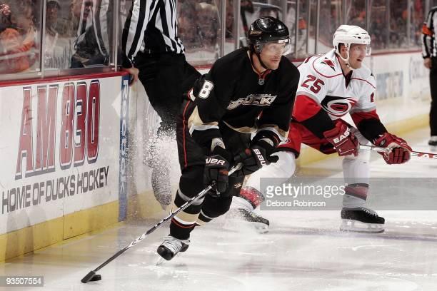 Joni Pitkanen of the Carolina Hurricanes defends against Teemu Selanne of the Anaheim Ducks during the game on November 25, 2009 at Honda Center in...