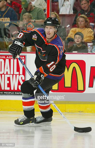 Joni Pitkanen of the Philadelphia Phantoms looks to make a pass play against the Hamilton Bulldogs during the American Hockey League game on October...